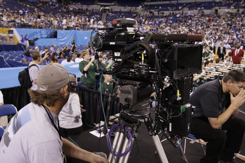 The Many Obligations Filled In by a Sports Broadcast